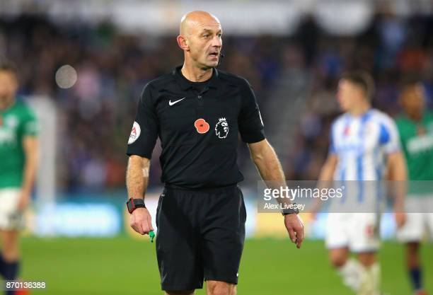 Referee Roger East looks on during the Premier League match between Huddersfield Town and West Bromwich Albion at John Smith's Stadium on November 4...