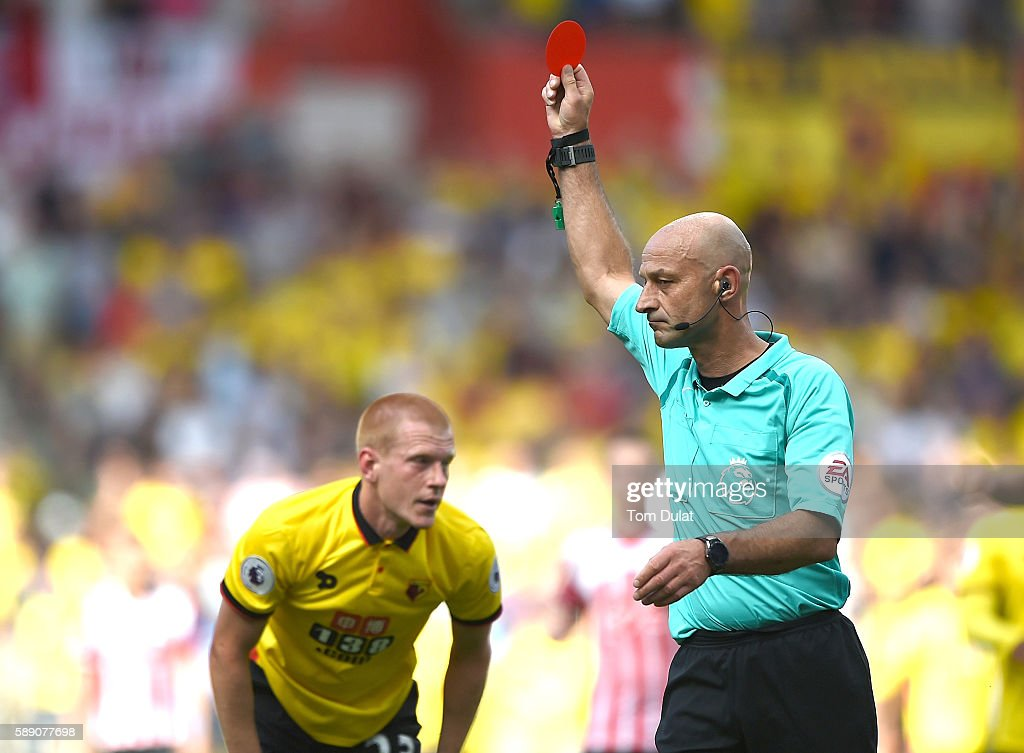 Referee Roger East sends off Ben Watson of Watford during the Premier League match between Southampton and Watford at St Mary's Stadium on August 13, 2016 in Southampton, England.