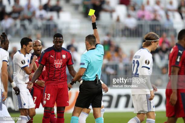 Referee Roi Reinsheiber shows a red yellow to Younousse Sankhare of Bordeaux during the Europa League match between Bordeaux and FC Kobenhavn at...