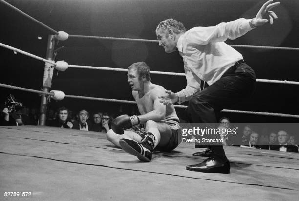 Referee Roland Dakin counts out Danny McAlinden in the 9th round of his British and Commonwealth Heavyweight title boxing match against Bunny Johnson...