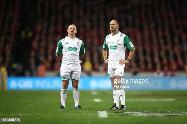 Referee Romain Poite and assistant Jaco Peyper watch the replay screen during the Test match between the New Zealand All Blacks and the British Irish...