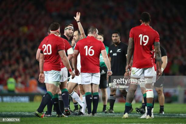 Referee Romain Poite downgrades a call made in the final minutes from a penalty to a scrum during the Test match between the New Zealand All Blacks...