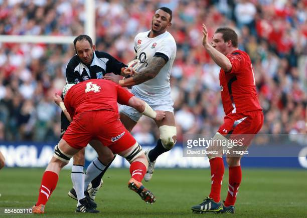 Referee Romain Poite gets caught in a tackle between England's Courtney Lawes and Wales Jake Ball during the RBS Six Nations match at Twickenham...