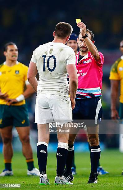 Referee Romain Poite shows Owen Farrell of England a yellow card during the 2015 Rugby World Cup Pool A match between England and Australia at...