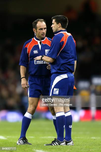 Referee Romain Poite talks to assistant George Clancy