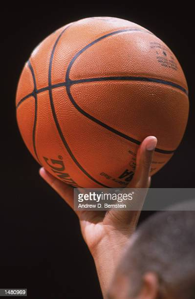 Referee Ron Garretson holds the ball during the NBA preseason game between the Memphis Grizzlies and the Los Angeles Clippers on October 13 2002 at...