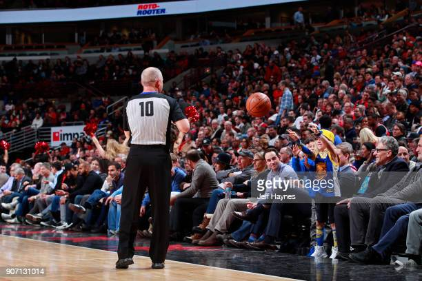Referee Ron Garretson tosses the ball to a youn fan in the stands during the Golden State Warriors game against the Chicago Bulls on January 17 2018...