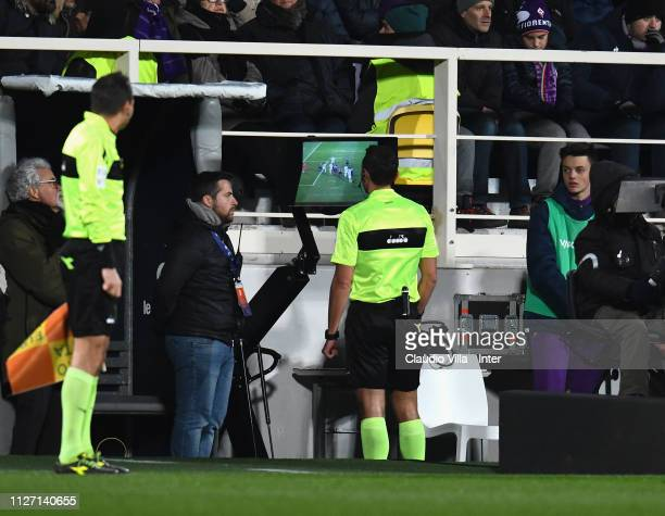 Referee Rosario Abisso watches a VAR monitor during the Serie A match between ACF Fiorentina and FC Internazionale at Stadio Artemio Franchi on...
