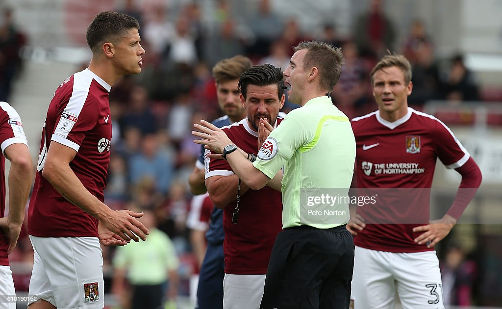 Referee Ross Joyce makes a point to Alex Revell of Northampton Town during the Sky Bet League One match between Northampton Town and Southend United at Sixfields on September 24, 2016 in Northampton, England.