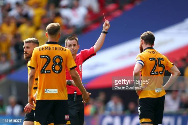 Referee Ross Joyce shows Mark O'Brien of Newport County a red card for a foul during the Sky Bet League Two Playoff Final match between Tranmere...