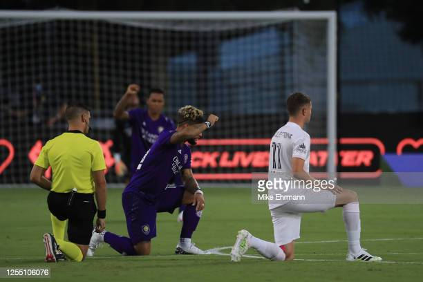 Referee Rubiel Vazquez, Dom Dwyer of Orlando City and Matias Pellegrini of Inter Miami 'take a knee' in support of the Black Lives Matter movement...