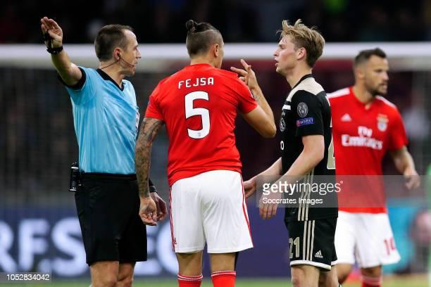 referee Ruddy Buquet Ljubomir Fejsa of Benfica Frenkie de Jong of Ajax during the UEFA Champions League match between Ajax v Benfica at the Johan...