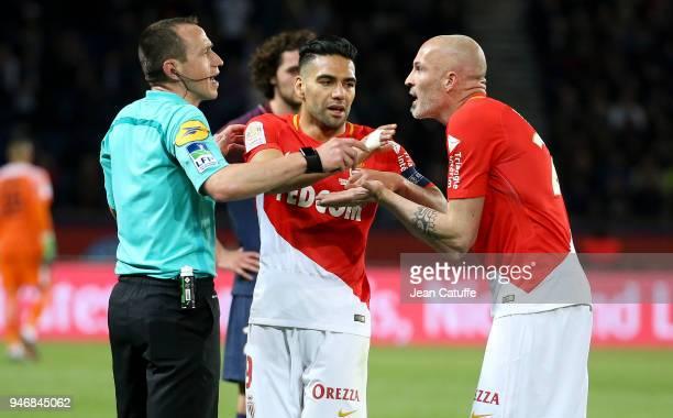 Referee Ruddy Buquet Radamel Falcao and Andrea Raggi of Monaco during the Ligue 1 match between Paris Saint Germain and AS Monaco at Parc des Princes...