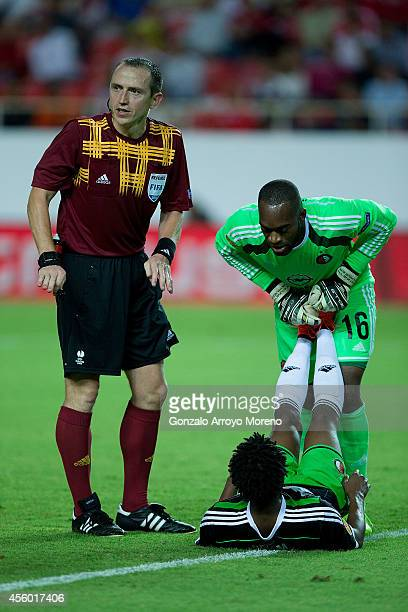 Referee Ruddy Buquet stops the match as goalkeeper Kenneth Vermeer of Feyenoord helps his teammate Miquel Nelom during the UEFA Europa League group G...