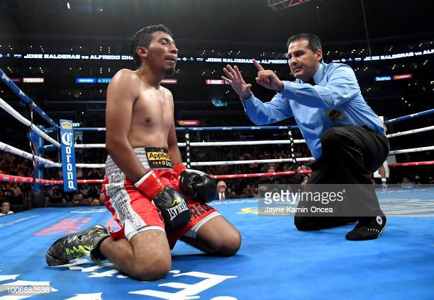 Referee Rudy Barragon gives Alfredo Chanez a 10 count after he was knocked down by Jose Balderas during their Junior Flyweight fight at Staples...