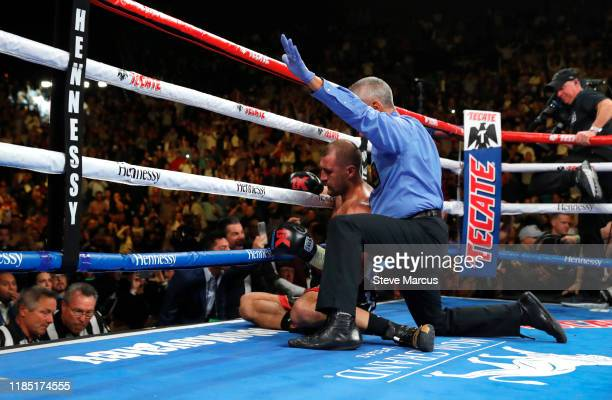 Referee Russell Mora calls off the WBO light heavyweight title fight between Canelo Alvarez and Sergey Kovalev after Alvarez knocked out Kovalez in...