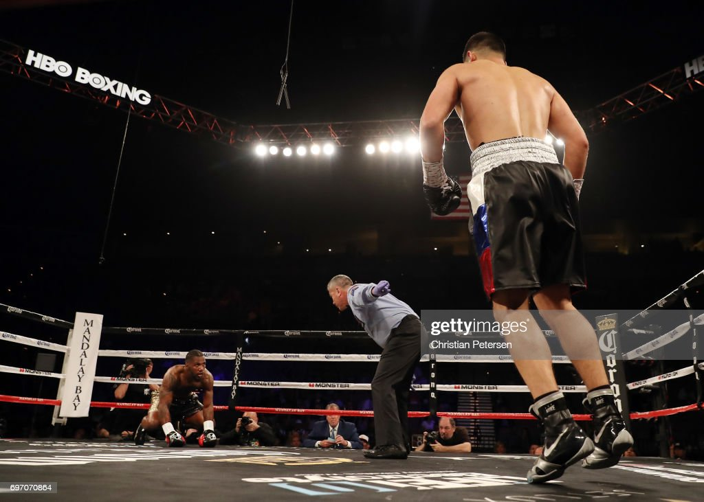 Referee Russell Mora (C) directs Dmitry Bivol (R) to a corner as his watches Cedric Agnew rise from the canvas during their light heavyweight bout at the Mandalay Bay Events Center on June 17, 2017 in Las Vegas, Nevada. Bivol won by fourth-round TKO.