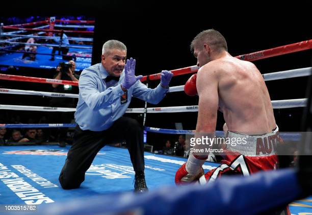 Referee Russell Mora gives a count to Liam Smith of England after he was knocked down by WBO junior middleweight champion Jaime Munguia of Mexico in...