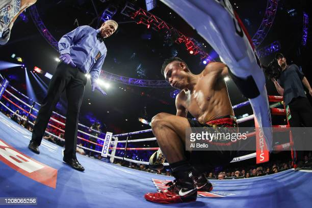 Referee Russell Mora looks on as Jeo Santisima is knocked down during his bout for Navarrete's WBO junior featherweight title against Emanuel...