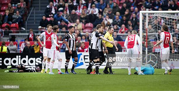 Referee Ruud Bossen gives Ajax Amsterdam's goalkeeper Kenneth Vermeer a red card after a foul on Heracles Almelo's player Geoffrey Castillion during...