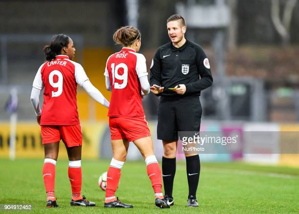 Referee Ryan Atkin issued a yellow card to Jemma Rose of Arsenal during Continental Tyres Cup semifinals match between Reading FC Women against...