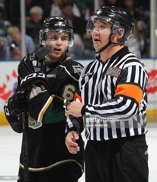 Referee Ryan Park chats with Ryan Rupert of the London Knights in an OHL game against the Sarnia Sting on January 1 2013 at the Budweiser Gardens in...