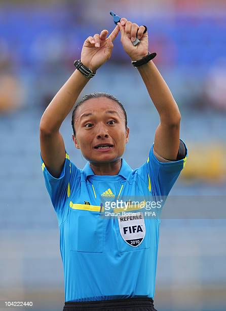 Referee Sachiko Yamagishi during the FIFA U17 Women's World Cup Quarter Final match between Spain and Brazil at the Ato Boldon Stadium on September...