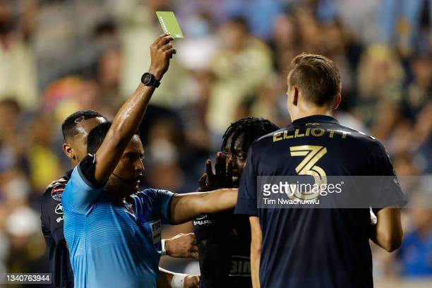 Referee Said Martinez issues a yellow card to Jakob Glesnes of Philadelphia Union during the semifinal second leg match against Club America of the...