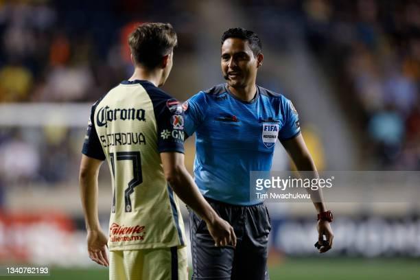 Referee Said Martinez speaks with Sebastián Córdova of Club America during the semifinal second leg match between Philadelphia Union and Club America...