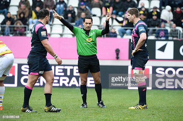 Referee Salem Attalah gives a yellow card to Pascal Pape of Stade Francais during the French Top 14 rugby union match between Stade Francais Paris v...