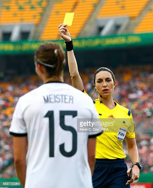 Referee Salome Di Iorio of Argentina hands out a yellow card to Wibke Meister of Germany during the FIFA U20 Women's World Cup Canada 2014 Quarter...
