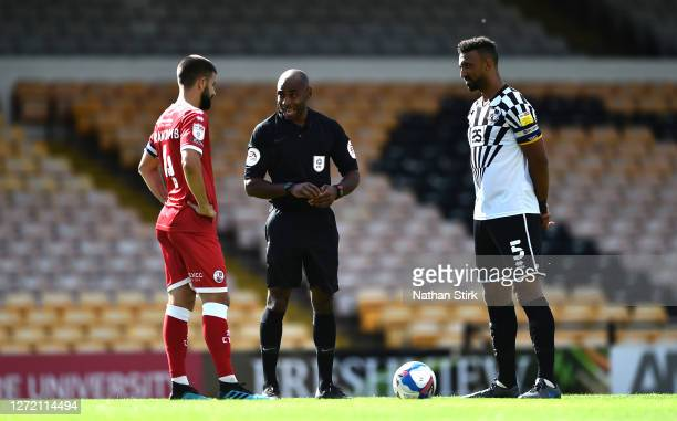 Referee, Sam Allison does the coin toss with captains George Francomb of Crawley Town and Leon Legge of Port Vale during to the Sky Bet League Two...