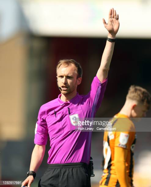 Referee Sam Purkiss signals during the Sky Bet League One match between Lincoln City and Hull City at Sincil Bank Stadium on April 24, 2021 in...