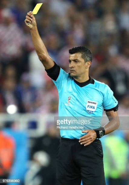 Referee Sandro Meira Ricci awards a yellow card during the 2018 FIFA World Cup Russia group D match between Croatia and Nigeria at Kaliningrad...