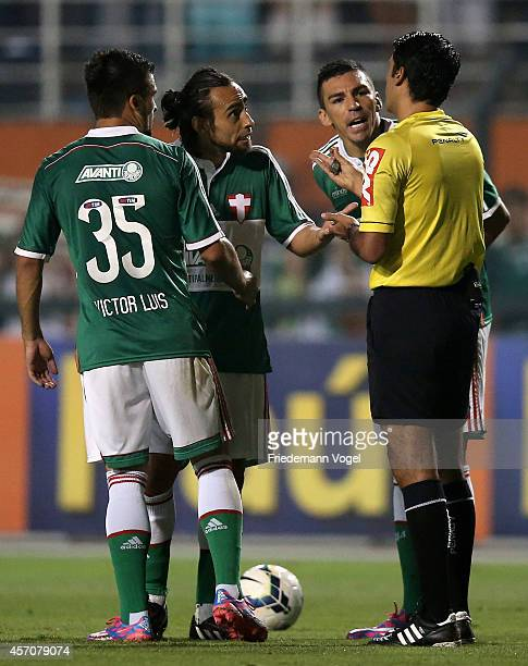 Referee Sandro Meira Ricci gives advise during the match between Palmeiras and Gremio for the Brazilian Series A 2014 at Estadio do Pacaembu on...