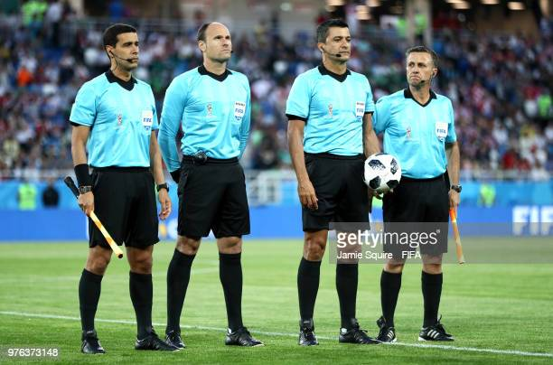Referee Sandro Ricci and his assistants Emerson De Carvalho Marcelo Van Gasse and Antonio Mateu Lahoz line up prior to the 2018 FIFA World Cup Russia...