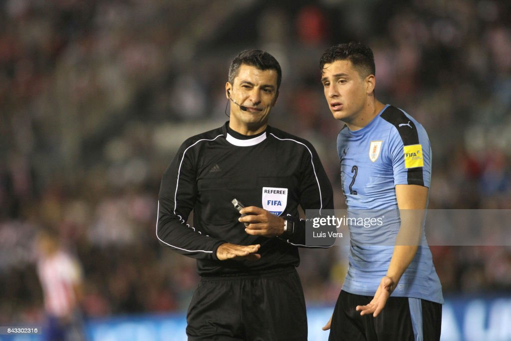 Referee Sandro Ricci argues with José María Gimenez of Uruguay during a match between Paraguay and Uruguay as part of FIFA 2018 World Cup Qualifiers at Defensores del Chaco Stadium on September 05, 2017 in Asuncion, Paraguay.