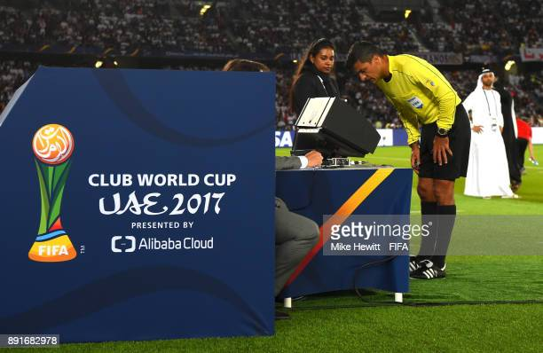 Referee Sandro Ricci looks at the video footage during the FIFA Club World Cup UAE 2017 semifinal match between Al Jazira and Real Madrid on December...