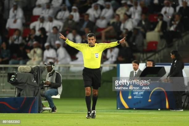 Referee Sandro Ricci of Brazil gestures after a video replay decision during the FIFA Club World Cup UAE 2017 semifin al match between Al Jazira and...