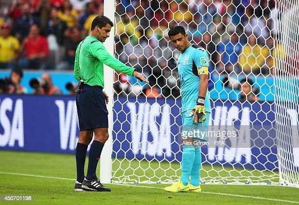 Referee Sandro Ricci talks to goalkeeper Noel Valladares of Honduras during the 2014 FIFA World Cup Brazil Group E match between France and Honduras...