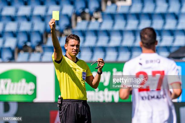 Referee Sandro Schärer shows a yellow card for Arbenit Xhemajli of Xamax FCS during the Swiss Raiffeisen Super League match between FC Luzern and...