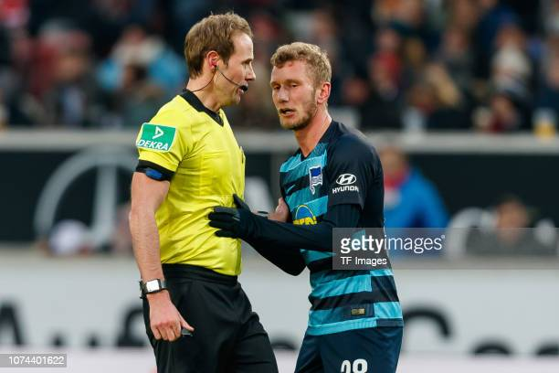Referee Sascha Stegemann discusss with Fabian Lustenberger of Hertha BSC during the Bundesliga match between VfB Stuttgart and Hertha BSC at...