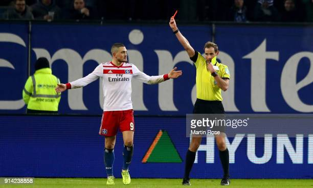 Referee Sascha Stegemann shows the yellow red card to Kyriakos Papadopoulos during the Bundesliga match between Hamburger SV and Hannover 96 at...