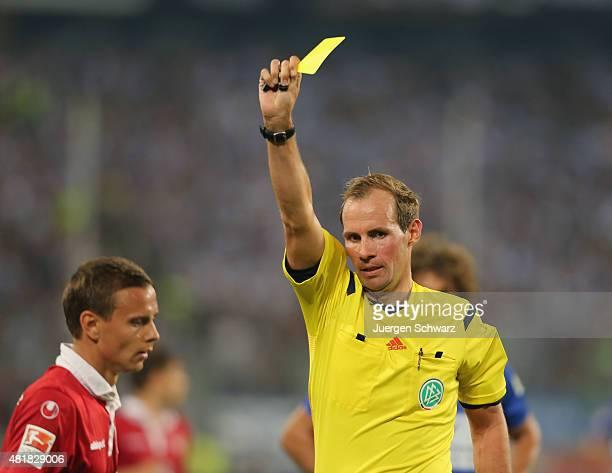 Referee Sascha Stegemann shows Yellow Card to Chris Loewe of Kaiserslautern during the 2nd Bundesliga match between MSV Duisburg and 1 FC...