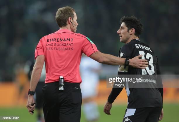 Referee Sascha Stegemann speaks with Lars Stindl of Borussia Moenchengladbach during the Bundesliga match between Borussia Moenchengladbach and FC...
