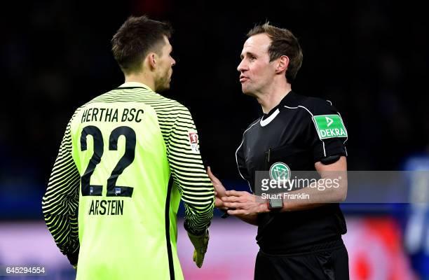 Referee Sascha Stegemann talks to Rune Jarstein goalkeeper of Berlin during the Bundesliga match between Hertha BSC and Eintracht Frankfurt at...