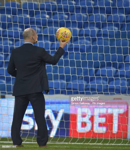 Referee Scott Duncan tests the goal line technology before the Sky Bet Championship match at the Cardiff City Stadium