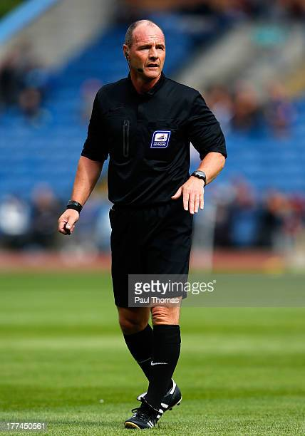 Referee Scott Duncan watches on during the Sky Bet Championship match between Burnley and Yeovil Town at Turf Moor on August 17 2013 in Burnley...