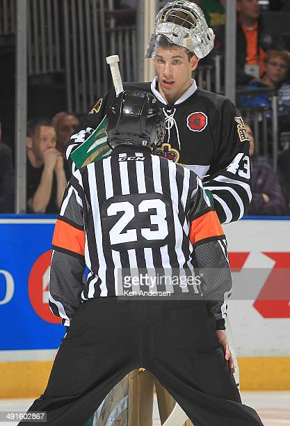 Referee Scott Oakman listens to Anthony Stolarz of the London Knights after he took a hit to the head against the Val'Dor Foreurs in Game One of the...