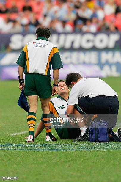 Referee Scott Young recieves attention from Tommy Smook during the Super 12 match between the Bulls and the Chiefs at the Securicor Loftus Stadium on...